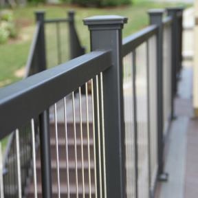 The clean clear lines of the Fortress Vertical Cable Railing system provide design details to your deck.