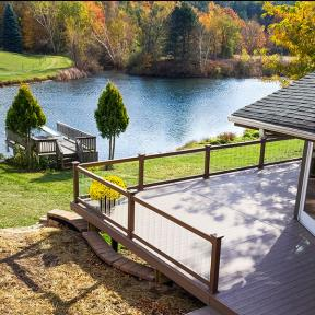 Genovations PVC decking, shown in Chestnut, creates a smooth, open outdoor space for your family and friends to gather.