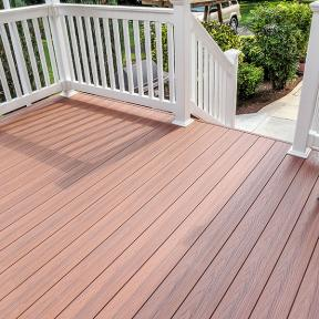 The warm look of Genovations PVC deck boards, shown in Chestnut, provides a natural feel to your outdoor space.
