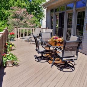 Rich, multi-tonal Genovations PVC deck boards in Dark Oak delightfully blends your deck with the beauty of your back yard.