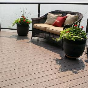 Create a cozy space to look out on the lake with Genovations PVC deck boards, shown in Sandalwood.