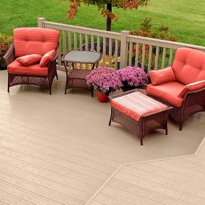 Blending brightly color patio furniture with the blossoming blooms surrounding your space helps your Genovations PVC decking blend into the background.