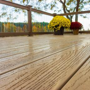 With a natural-looking wood grain texture, Genovations PVC decking, shown in Sandalwood, feels and looks authentic.