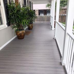 Add dimension and image of length to your outdoor living area with the natural streaked look of Genovations PVC decking in Weathered Wood.