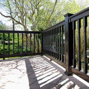 Illusions Vinyl Railing with Black Colonial Spindle Balusters, T-Rail Rail in Black