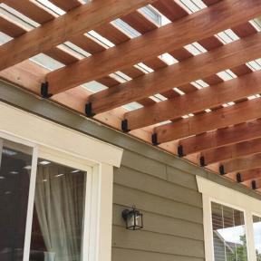 Pergola featuring Joist Hangers by OZCO Ornamental Wood Ties
