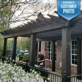 Sit in the shade with the pergola built using OZCO Laredo Sunset Wood Ties