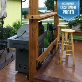 Backyard grill area featuring the Post to Beam Bracket by OZCO Ornamental Wood Ties