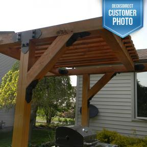 This image shows an outrdoor grill and kitchen area built using the Truss Accents and Inside Flush Tie Plate from OZCO Ornamental Wood Ties