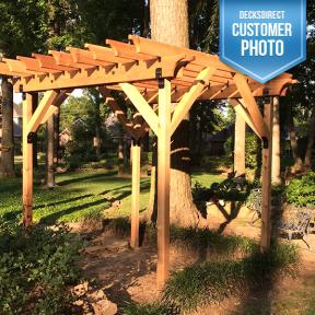 A backyard pergola with Ornamental Inside Flush Plate, Rafter Clips, Timber Bolts and Timber Screws by Ozco Ornamental Wood Ties.