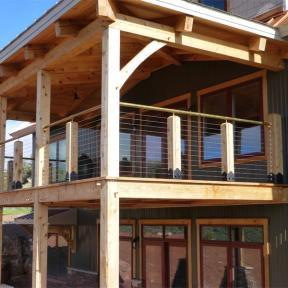 Second Story Deck featuring the Post Base Kit by OZCO Ornamental Wood Ties
