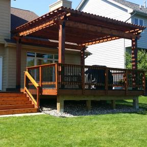 Deck Pergola featuring the Post Base Kit, Rafter Clips and Post to Beam Bolt Bracket by OZCO Ornamental Wood Ties