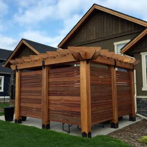 Enclosed Pergola featuring the Post Base Kit, Post to Beam Bolt Bracket, and Rafter Clips by OZCO Ornamental Wood Ties