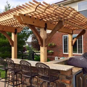 Grill Pergola featuring the Post to Beam Bolt Bracket, Timber Bolts, and Rafter CLips by OZCO Ornamental Wood Ties