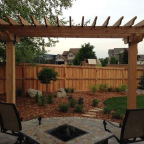 Fireplace Pergola featuring the Post to Beam Bolt Bracket and Rafter Clips by OZCO Ornamental Wood Ties