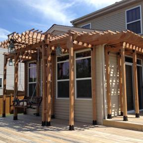 Deck Pergola featuring the Post Base Kit, Rafter Clips, 90° Flush Inside Tie Plate, Timber Bolts, Timber Screws, and the Heavy Duty Timber Bolt Washer by OZCO Ornamental Wood Ties