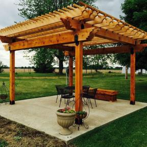 Patio Pergola featuring the Post Base Kit, Post to Beam Bolt Bracket, and Rafter Clips by OZCO Ornamental Wood Ties