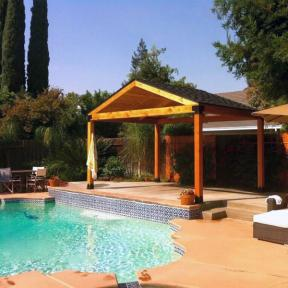 Pool Patio Pavilion featuring the Post Base Kit by OZCO Ornamental Wood Ties