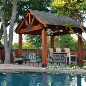 Pool Patio Pavilion featuring the Post Base Kit, Truss Base Fan, Laredo Sunset Truss Tie Plate, and Truss Accents by OZCO Ornamental Wood Ties