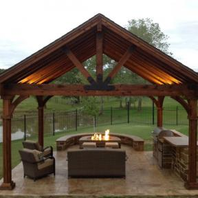Fireplace pavilion featuring the Truss Base Fan, Truss Accents, and Post to Beam Bolt Brackets by OZCO Ornamental Wood Ties