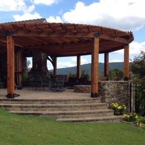 Round Pergola featuring the Post Base Kit and 45° Inside Flush Tie Plate by OZCO Ornamental Wood Ties