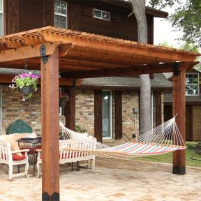 Patio Pergola featuring the Post Base Kit, Post to Beam Bolt Bracket, and Rafter Clips