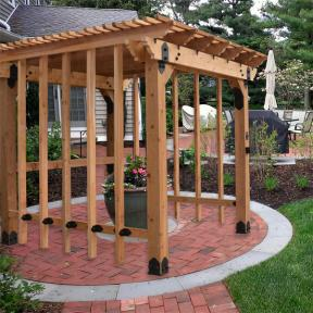 10' x 10' Patio Pergola featuring the Post Base Kit, Post to Beam Bolt Bracket, Rafter Clips, Laredo Sunset Flush Inside Tie Plate, and Timber Bolts by OZCO Ornamental Wood Ties