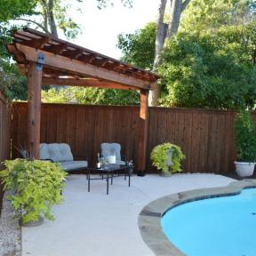 Pool Side Pergola featuring the Post Base Kit, Post to Beam Bolt Bracket, and Rafter Clips by OZCO Ornamental Wood Ties