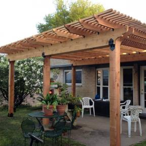 Patio Pergola featuring the Post Base Kit, Post to Beam Bracket, and Rafter Clips by OZCO Ornamental Wood Ties