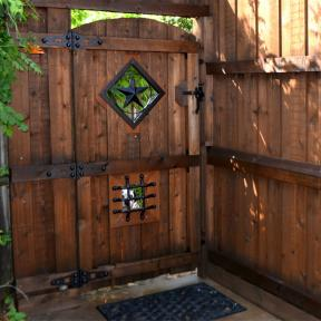Fence Gate featuring the Hing Kit, STar Ornamental Accent and Speak Easy Ornamental Accent by OZCO Ornamental Wood Ties