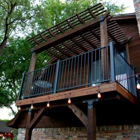 Second Story Deck with a Pergola all featuring the Post Base Kit, Laredo Sunset Truss Tie Plate, Truss Accents, and the Post to Beam Bracket by OZCO Ornamental Wood Ties