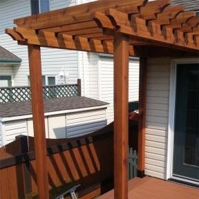 Deck Pergola featuring Rafter Clips by OZCO Ornamental Wood Ties