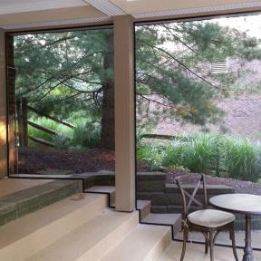 SCREENEZE® Screen Frame Kit Project shown on an outdoor porch area