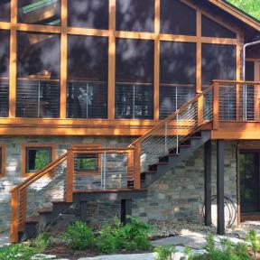 Feeney CableRail with Quick-Connect® Surface Mount assemblies and intermediate pickets installed with screened porch and custom wood posts and rails