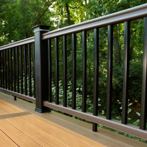 TimberTech RadianceRail in Traditional Walnut with Black Balusters, Post Sleeves, and Post Caps. Also features TimberTech DeckLites LED Post Light Modules.