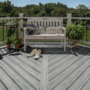 Tie your space together by coordinating your patio furniture, railing and Trex Enhance in Rocky Harbor.