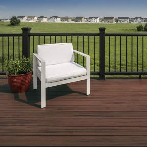 Give your deck more depth with Trex Enhance in a contrasting color to your yard such as Sunset Cove.