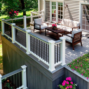 A perfect space complete with deck furniture that keeps the storage space below dry thanks to Trex RainEscape