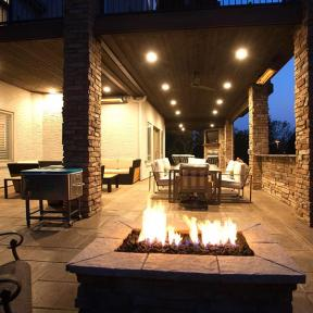 An Evening oasis thanks to Trex RainEscape! Enjoy dinner and sip wine by the fireplace without worrying about the elements.