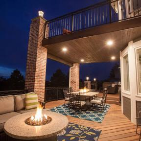 With Trex RainEscape finished off with outdoor recessed lighting allows you and your guests to see their dinner when eating on the deck.