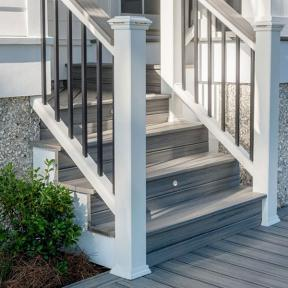 Unite your space with Trex Transcend in Island Mist as both decking and a top rail for your Trex Transcend railing.