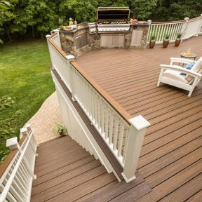 Complete your backyard space with Trex Transcend decking in Havana Gold as a top rail for your Trex Transcend railing.
