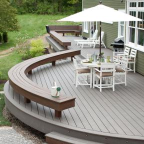 Trex Transcend, here in Island Mist, can be curved to help accent furniture and create exclusive deck designs.