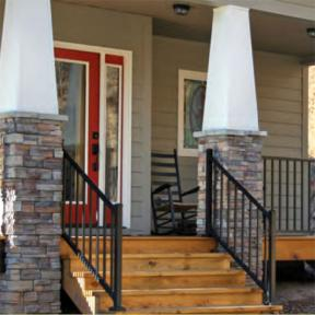 Westbury Tuscany Series Aluminum Railing in Black Fine Texture. Also features Westbury Post Skirts and Post Caps.