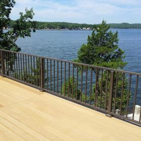 Westbury Tuscany Series Aluminum Railing in Bronze Fine Texture with Crossover Posts. Also features Westbury Crossover Brackets and Post Skirts.