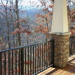 Westbury Tuscany Series Aluminum Railing in Black Fine Texture. Also features Westbury Crossover Brackets, Post Skirts and Post Caps.