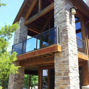 Westbury Veranda Glass Railing in Bronze Fine Texture.