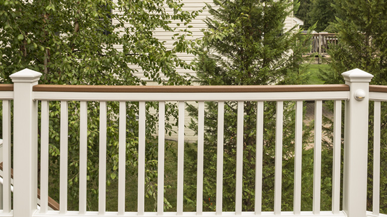 Trex Classic White Pyramid Post Caps top off a Transcend Railing section with deck board top rail