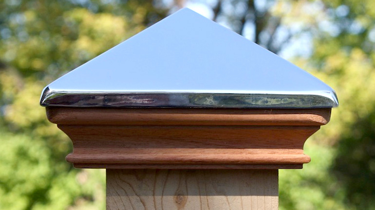 Detail image of a Wood-base post cap with real Stainless Steel pyramid topper