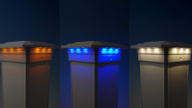 A white solar post cap light by Ultra Bright for AZEK TimberTech RadianceRail Post Sleeves is shown in front of a blue background displaying LED color modes of amber, blue and white